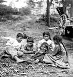 Iroquois Tribe: Group of Children Beside Wooden Boat